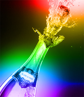 Photo of champagne bottle exploding in celebratory mode