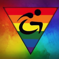 A triangle made up of rainbow colors with the symbol of a person in a wheelchair